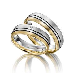 Eheringe Merii: Silber 925/- Gelbgold 585/- Breite: 6,00 - Höhe: 2,00 - Steinbesatz: 1 Brillant 0,015 ct. tw, si (Ring 1 mit Steinbesatz, Ring 2 ohne Steinbesatz). Alle Eheringe können individuell nach Ihren Wünschen konfiguriert werden.