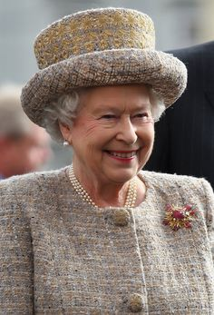 The Queen in Ljublijana, Slovenia during a State visit in Oct 2008, she then went to Lipica to see the Lippizzaner horses. Wearing her Grima Gold & Ruby brooch given to her by the Duke of Edinburgh in 1966.