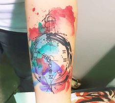 Very pretty 3 colors watercolor tattoo style of Pocket Watch motive done by artist Marco Pepe