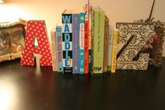 A-Z bookends for playroom @Erica Holland if you wanted to do a whole library & letters theme for the shower... this is super cute for a kids library!!!