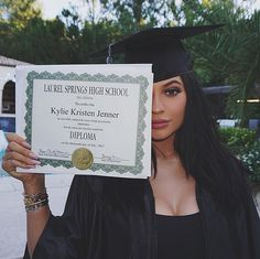 Kylie Jenner reminding us just how young and successful she is after her high school graduation.