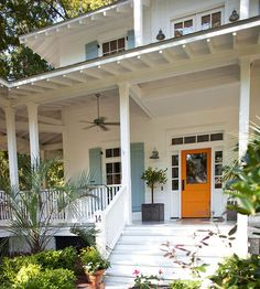 Citrus orange creates an exciting entrance on this spacious porch. More ways to add color to your exterior: http://www.bhg.com/home-improvement/exteriors/curb-appeal/add-exterior-color/?socsrc=bhgpin051513orangedoor=5