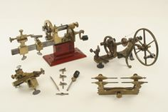 a small English mandrel, a large clockmakers brass depthing tool, and a watchmakers staking set