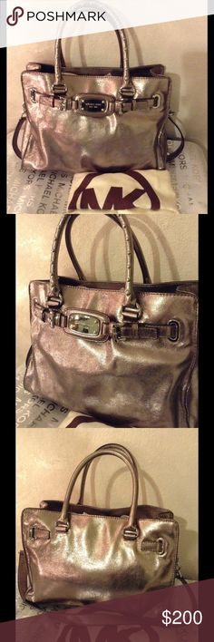 Michael Kors Large Hamilton With Studs Silver, shiny and studded, thats what this bag truly stand out. Minimal wear only. Has 3 main compartments and several pockets for organized belongings. Soft leather with durable studded handles and thick printed Michael Kors lining. Dustbag included. 💟Authentic Michael Kors💟 Michael Kors Bags Satchels