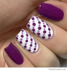 Purple and white manicure with polka dots