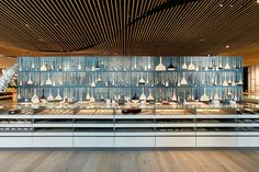 Thousands of pigments fill glass vials below the slatted wood ceilings of the new concept Pigment, an art supply laboratory and store that just opened in Tokyo by company Warehouse TERRADA.The store design was created by architect Kengo Kuma, utilizing bamboo and large open spaces to create a s
