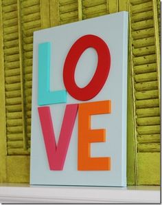 """not this sign - but get 4 large moving boxes and spray paint white or pink, then add colorful letters to each = large """"love blocks"""" to stack"""