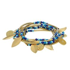 7 multicolored blue tone beaded stretch bracelets featuring gold tone bars and leaf shaped charms.