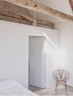 scandinavian cottage white beach house summer house lake wooden beams bedroom simple minimal minimalist home decor string chair serene
