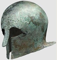 Corinthian helmet, 7th/6th century B.C.  Thick-walled, heavy, bronze Corinthian helmet with a tall skull and extended neck-guard. Large eye cutouts, slightly concave cheekpieces and a sturdy riveted long nose-guard bent outwards. Surrounded with drilled holes, some in pairs, and some still retaining the decorative or lining rivets with round heads, 22 cm high. Private collection, from Hermann Historica auction