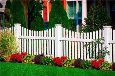 This vinyl picket fence gives the illusion of wood without the rot. By Illusions Vinyl Fence. For more fencing style ideas visit: http://www.landscapingnetwork.com/fencing/styles.html
