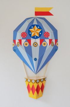 This joyful, blue stripey, geometric, 3D, Hot Air Balloon, Paper Craft was originally created using my signature paper cut technique (and a lot