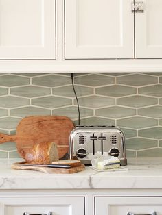 Keep your toaster on a tray to catch all the crumbs. It also makes it very easy to move it around to clean or put it away when you want your counters clutter-free