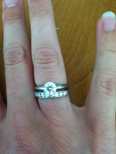 Solitaire engagement ring with a channel set wedding band.