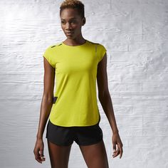 Sweat can really put a damper on things when you're hitting your groove. Lucky for you, this short sleeve tee boasts PlayDry tech to keep moisture at bay, no matter how hard you push the limits. A cleverly contoured hem adds feminine flair. Reebok Clothes, Tumblr T Shirt, T Shirt Vest, Workout Tops, Sports Women, Cotton Tee, Short Sleeve Tee, Active Wear, Sportswear
