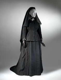 Deep mourning dress entirely of crepe ca. 1875.