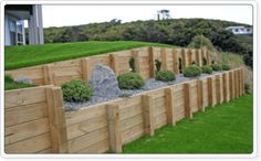View our range of timber and concrete retaining wall options for residential and commercial properties in Auckland. Concrete Works specialise in building retaining walls of all shapes, sizes and budgets. Wooden Retaining Wall, Backyard Retaining Walls, Retaining Wall Design, Building A Retaining Wall, Concrete Retaining Walls, Cheap Retaining Wall, Hillside Landscaping, Outdoor Landscaping, Landscape Walls