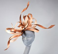 Headwear, 2011 | Milliflorae by Kate Jones | Materials: oak, cherry, mahogany | Heat was used to form the organic flow and manually control the movement and shape of this piece | 2nd place in Stephen Jones and Talenthouse's global millinery talent competition, which took place via Vogue UK's Facebook
