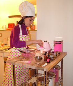 For a 2005 cosmetics launch, Bourjois Paris invited beauty editors to a model apartment at an unfinished apartment building in New York. Part of the unusual setting included a Bourjois product developer preparing pink eye shadow in the kitchen with the aid of a pink KitchenAid blender.