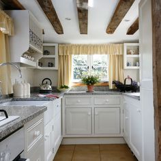 Rustic beams/faux beams might help widen the galley but I think they d need to be the opposite direction?