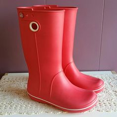 fd842d6a2c551 Shop Women s crocs Red size 7 Winter   Rain Boots at a discounted price at  Poshmark. Holes for easy on off.