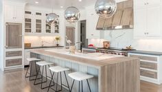 Natural wood and white cabinets; Kitchens with Pendant Lighting