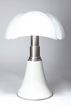"Early Pipistrello lamp designed by Italian designer Gae Aulenti c.1966 for Martinelli Luce, Italy. Original white painted base, stainless steel telescope, white opal plastic ""Bat"" diffuser + floor switch. Height adjusted by telescopic stem (can be set anywhere from 26"" to 34"")."