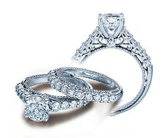 right here, this is my dream ring. especially the piece under the diamond, it looks like a tulip (my favorite flower!) gorgeous!