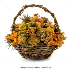 Arrangement of dried flowers in a basket by IIIadam36III, via Shutterstock