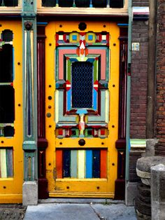 Love this bright cheery multi-colored door