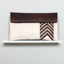 """White Arrow Clutch Espresso Front. """"Ssekos is products are hand-made by a group of young woman in Uganda who make the sandals, clutches and other products to earn money to finance their university education. """""""
