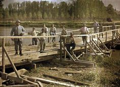 World War I in Color: French soldiers from a special unit build a wooden bridge across the Aisne, 1917.