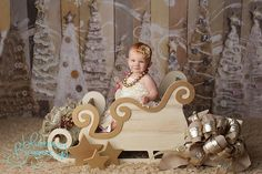 Holly-jolly cuteness in our large sleigh photo prop! www.mrandmrsandco.com