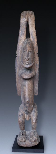 A Great male  Ancestor-figure nommo, Dogon-People, Mali  arms raised like swimmer, or two big ears
