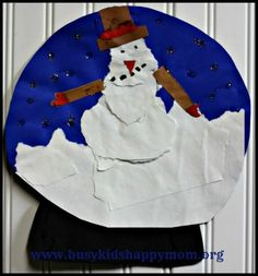 Snow Globe Paper Craft.... torn paper crafts really keep your child busy and content.  www.busykidshappymom.org