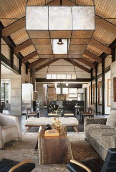 Huge open layout with vaulted wood panel ceiling