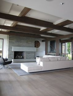 """""""The floor is a wide plank quarter sawn white oak floor, with a 2 pass stain in gray then white. It was inspired by drift wood."""""""