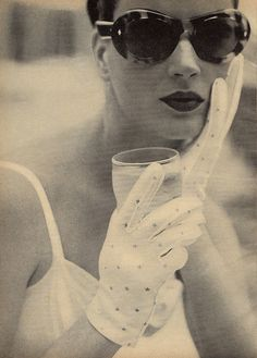 1950s Gloves & Shades, & most likely a cocktail.