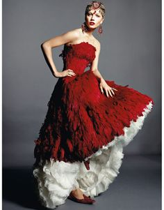oooh, love this dress with the feathery texture and and the undertones. what a gorgeous red.