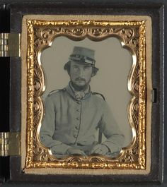 [Unidentified soldier in Confederate uniform and Crescent City Guards of New Orleans kepi]