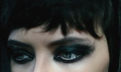 Her eye makeup is very appopriate for a rock star on a rock magazine. Her makeup is very bold, and it stand out, linking to rock music