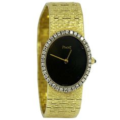 Piaget Lady's Yellow Godl and Diamond Bracelet Watch with Onyx Dial . Circa 1970s