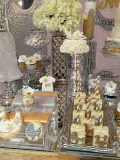 Stunning white and gold treats at a winter wonderland baby shower party! See more party planning ideas at CatchMyParty.com!