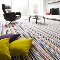 Modern #stripes in a minimalistic scene pop of colour with #bold #cushions #striped #carpet