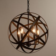 We're proud to present our exclusive Metal Orb Chandelier, finely crafted by artisans in India and available at an unbeatable value. With a sophisticated aged black finish that complements its impressive industrial style, this globe-like chandelier's timeless appeal will illuminate your home décor beautifully for years to come.