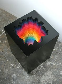 Jen Stark. Hand-cut paper, wood, foamcore / 2011