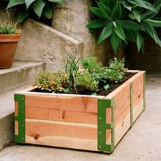I love the colored brackets holding this planter together!