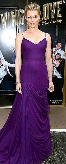 So regal! The former supermodel stepped out in a royal purple Vera Wang Collection gown with a bold draped effect.
