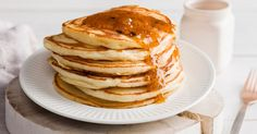 Breakfast is always better with a big pile of pancakes topped with sweet jam spread.