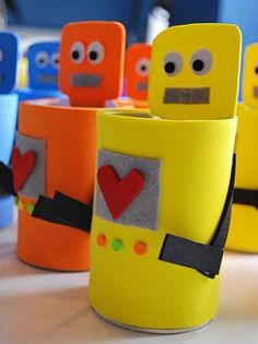 Robots made from paper tubes. Could be filled with candy as favors